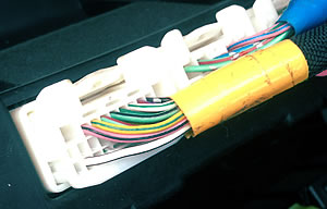 the power from the battery is carried to the electrical items via wires,  which are strands of copper wrapped in a coloured sleeve  there are  hundreds if not